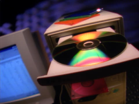 man putting cd-rom into computer - cd rom stock videos & royalty-free footage