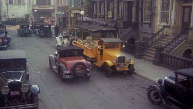 ws zi man putting garbage in garbage truck / united states - 1972 stock videos and b-roll footage