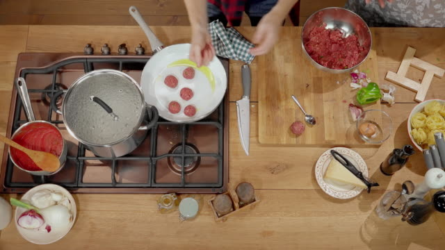ld man putting meatballs into the frying pan - meatballs stock videos & royalty-free footage