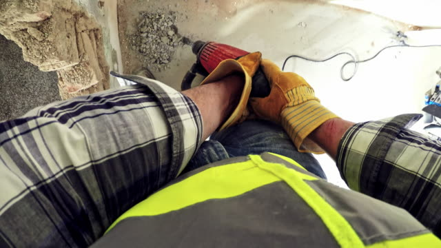 pov man putting on gloves and using a jackhammer to chisel away the floor in an old house - pneumatic drill stock videos & royalty-free footage