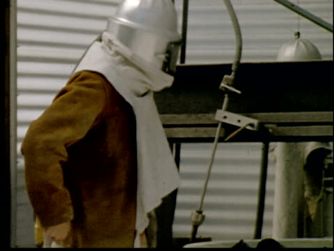 1955 ms zo man putting on protective mask and gloves and beginning work - helmet stock videos & royalty-free footage