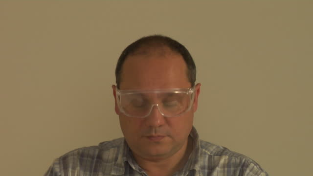 cu man putting on protective mask, eyewear and ear protectors, london, england - ear protectors stock videos and b-roll footage
