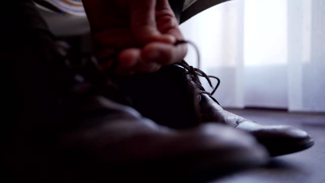 man putting on shoes - footwear stock videos & royalty-free footage