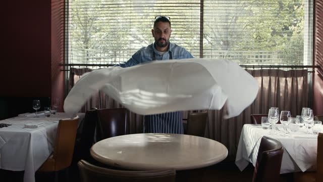 man putting tablecloth on table in restaurant - one man only stock videos & royalty-free footage