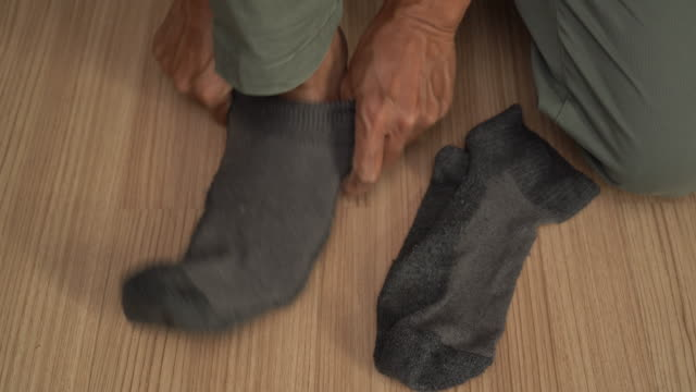 man putting torn sock - sock stock videos & royalty-free footage