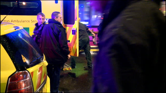 man questioned following stabbing at blackberry promotional event; england: london: southwark: pulse nightclub: ext / night various shots of police... - 刺傷事件点の映像素材/bロール