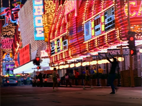 man raising arms excitedly on las vegas street with neon lights at night - 1997 stock videos & royalty-free footage