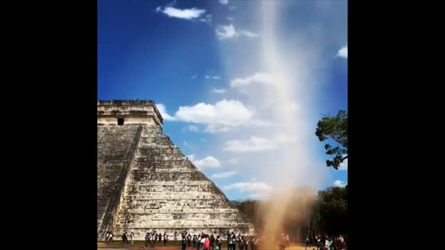 stockvideo's en b-roll-footage met man ran through a dust devil which had formed at the foot of the el castillo pyramid at chichén-itzá in yucatan, mexico, on thursday, march 21.... - https