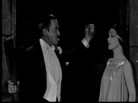 1925 cu b/w man ranting woman in dungeon - dungeon stock videos & royalty-free footage