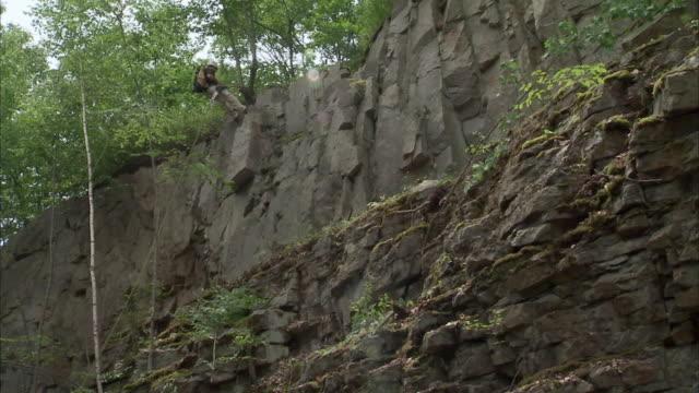WS LA Man rappelling down cliff / Rutland, Vermont, USA