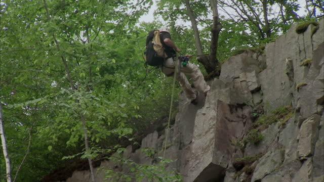 MS LA TD Man rappelling down cliff / Rutland, Vermont, USA