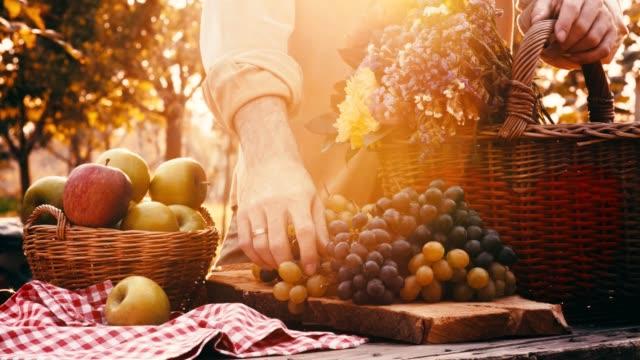 man reaching for grape - uva video stock e b–roll