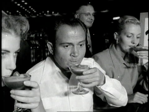 a man reacts to a frozen alcoholic drink - 1960 stock-videos und b-roll-filmmaterial