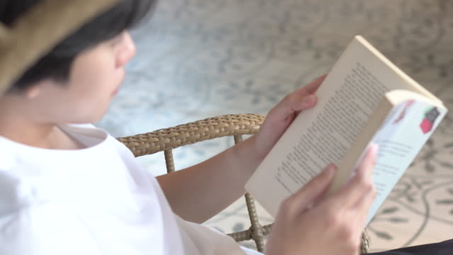 a man reading a book in the living room - chairperson stock videos & royalty-free footage