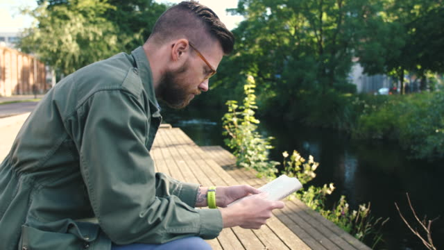 man reading a book - reading glasses stock videos & royalty-free footage
