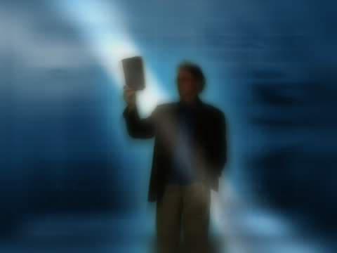 man reading book under ray of light, silhouette - digital enhancement stock videos and b-roll footage