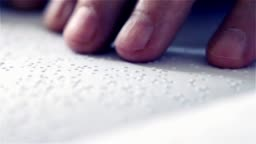 Man Reading Braille. Close-Up.