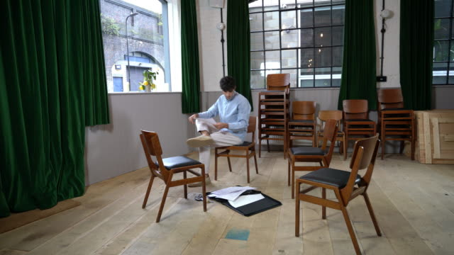 man reading documents in empty room - briefcase stock videos & royalty-free footage