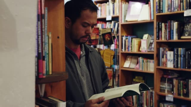 man reading in bookstore - only mature men stock videos & royalty-free footage