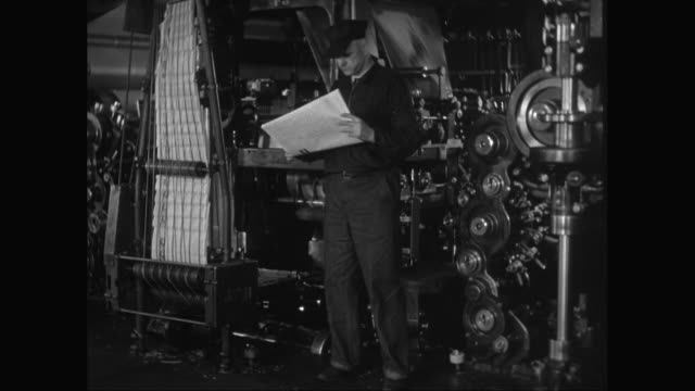 ms man reading newspaper in printing press / united states - material stock videos and b-roll footage