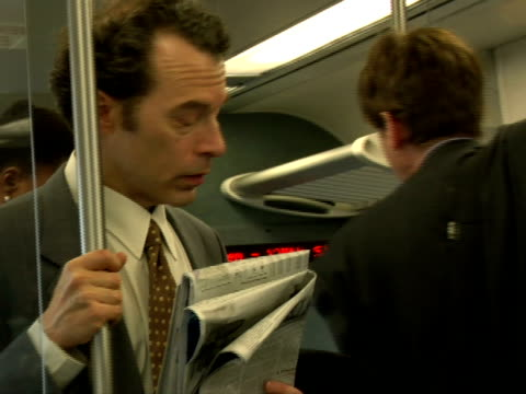 cu, man reading newspaper in subway train, chappaqua, new york state, usa - newspaper stock videos and b-roll footage