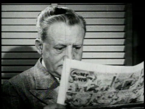 1948 montage man reading newspaper / united states - 1948 stock-videos und b-roll-filmmaterial