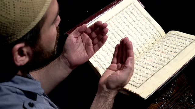 man reading quran - praying stock videos & royalty-free footage