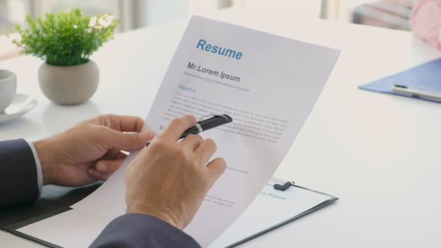 man reading resume while interviewing applicant at office background, job interview, job search, business concept - recruitment stock videos & royalty-free footage
