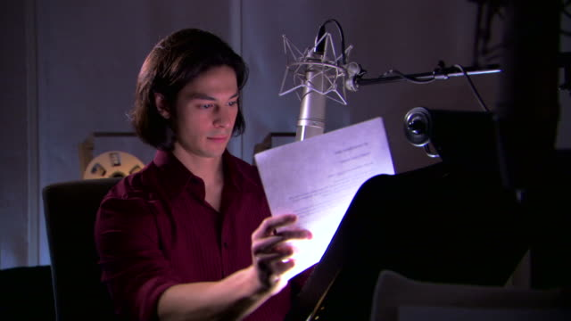 man reading script in recording studio - see other clips from this shoot 1429 stock videos & royalty-free footage