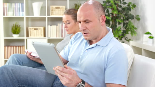 HD: Man Reading Shocking News On A Tablet