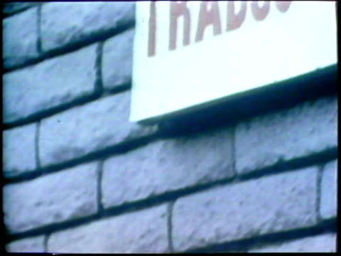 1973 montage td cu man reading sign outside employment agency/ ws man entering employment agency building/ usa/ audio - unemployment stock videos and b-roll footage