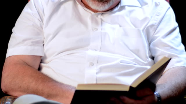 man reading story from a book - storyteller stock videos & royalty-free footage
