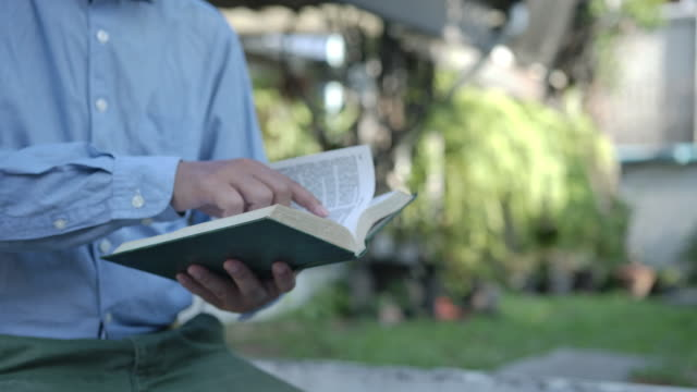 man reading the holy bible. - priest stock videos & royalty-free footage