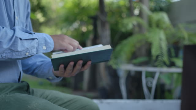 man reading the holy bible. - clergy stock videos & royalty-free footage