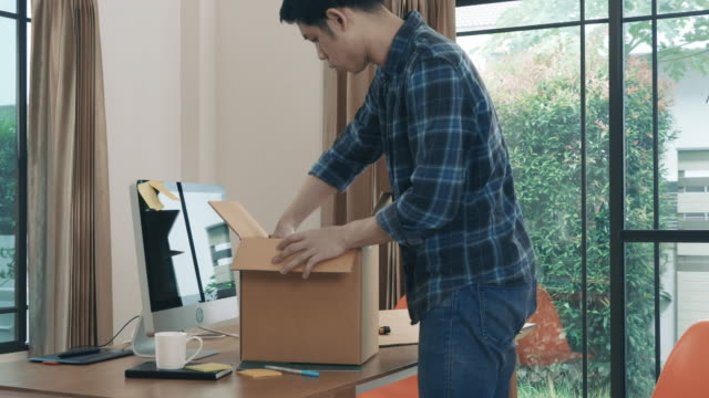 man receive package - cardboard box stock videos & royalty-free footage