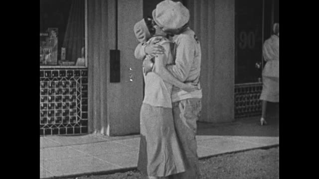 1932 man (bing crosby) receives a blow to the face after kissing an unavailable woman - assertiveness stock videos & royalty-free footage