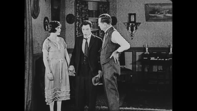 1922 man (buster keaton) receives an unfavorable response from his girlfriend's father when he asks for his permission to propose to her - blumenbouqet stock-videos und b-roll-filmmaterial