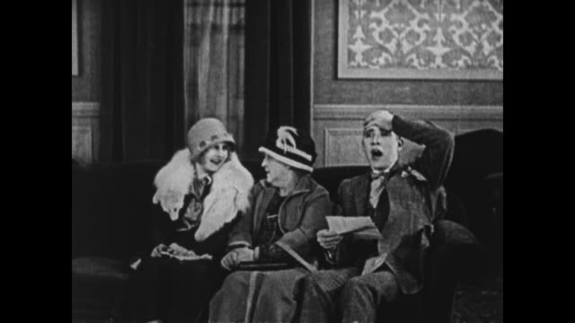 1924 man receives bad news as women watch, con man approaches - telegram stock videos and b-roll footage