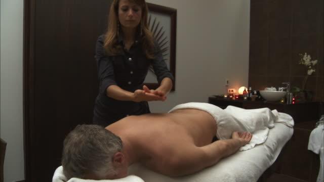 MS Man receiving back massage / Brussels, Belgium