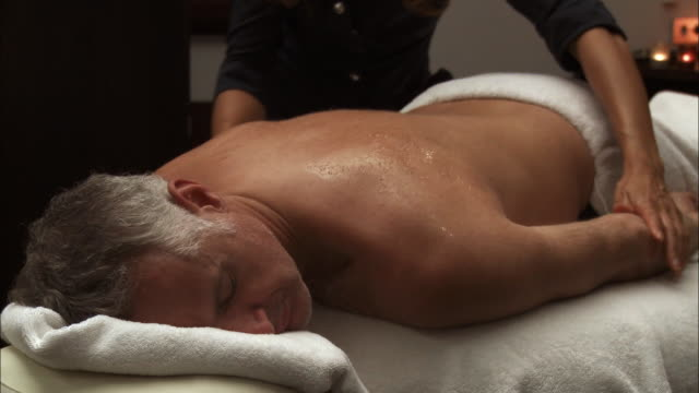 CU Man receiving back massage / Brussels, Belgium