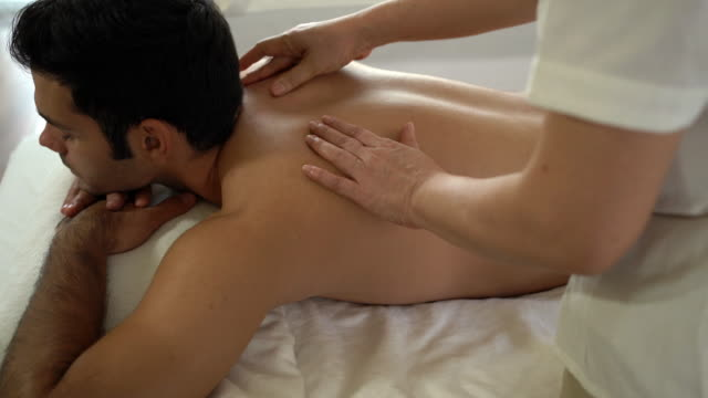 man receiving head massage at beauty spa - massage stock videos & royalty-free footage