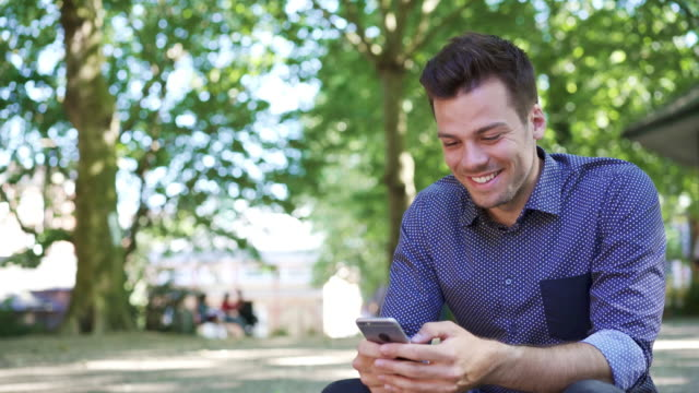 man receiving message, smiling, laughing and replying - answering stock videos & royalty-free footage