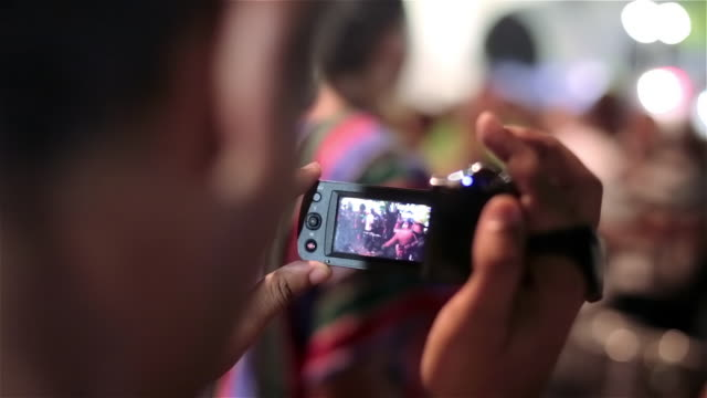 Man records Brazilian samba street performance with digital camcorder