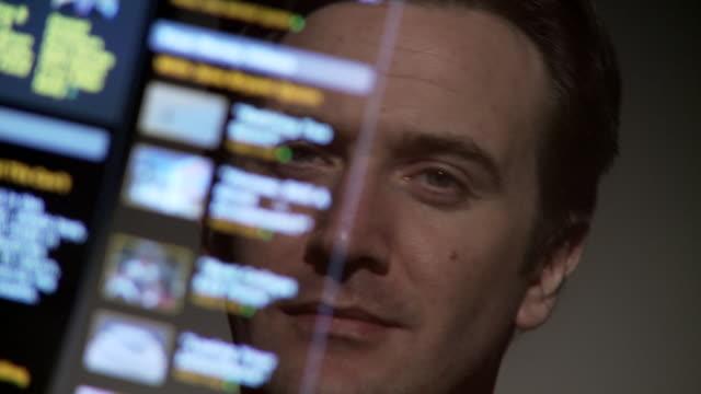 cu, pan, selective focus, man reflected in computer screen, atlanta, georgia, usa - see through stock videos & royalty-free footage