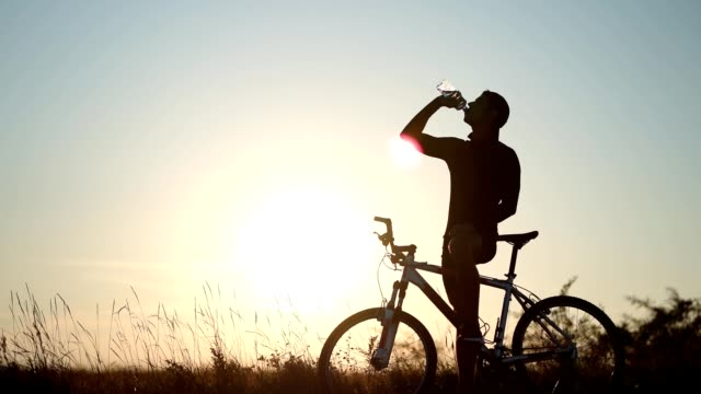 man refreshes with water in break of cycling - refreshment stock videos and b-roll footage