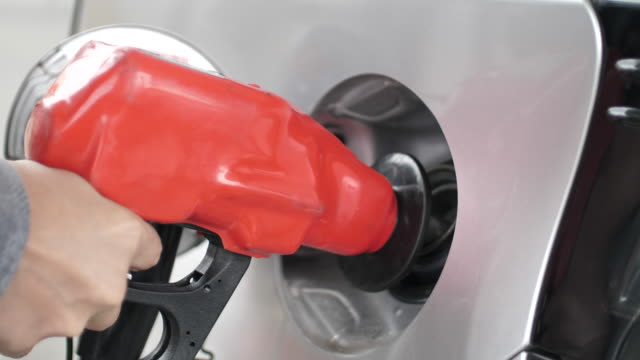 man refueling car at gas station pump - refuelling stock videos & royalty-free footage