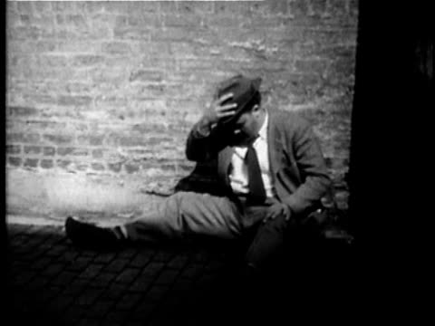 1949 b/w ws man regaining consciousness, standing up and walking away, usa, audio - alcohol abuse stock videos & royalty-free footage