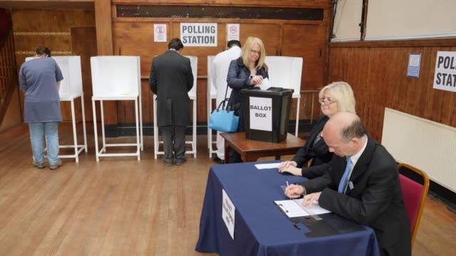 4K: Man registering to vote at the Election - Voting at Polling Place