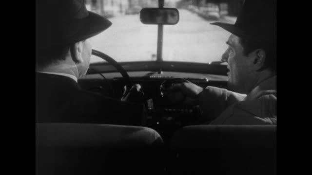1948 man rejects cigarette while driving - 断る点の映像素材/bロール