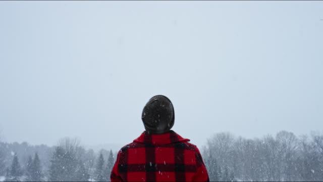 Man rejoicing in a winter's snowstorm